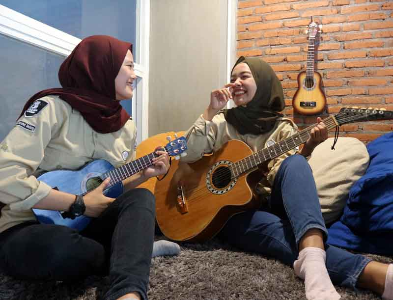 Enggar and Vinda play the guitar and ukulele - rest area in the office