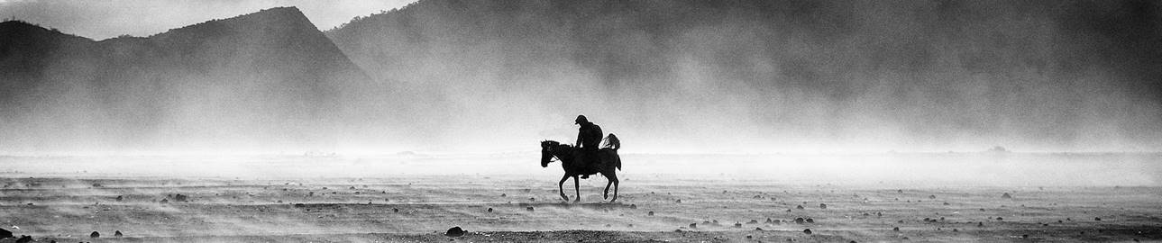 Bromo by horse - a horse man in the Bromo sand sea